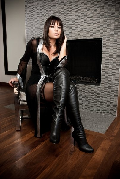 bald man is banging the busty brunette wearing black boots  66631